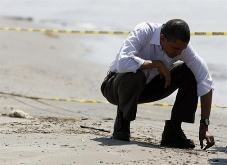 U.S. President Barack Obama picks up balls of tar while touring the beach on May 28, 2010 in Grand Isle, Louisiana. The oil spill resulting from the Deepwater Horizon disaster now officially ranks as the worst in U.S. history. UPI/David Grunfeld/Pool Photo via Newscom